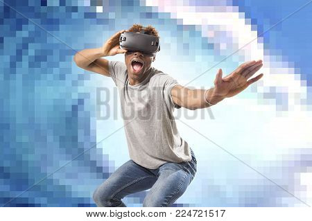 young attractive afro American man using vr virtual reality 3D goggles playing surf videogame with pixelated computer sea wave background in gaming fun and new technology concept