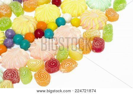 Multi-colored sweets on a white background. Sweets sweet on white background. Dessert for children.