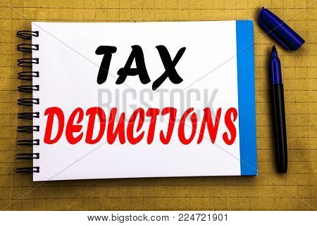 Tax Deductions. Business concept for Finance Incoming Tax Money Deduction Written on notepad paper background with space office view with pencil marker