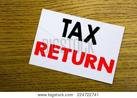 Tax Return. Business concept for Accounting Money Return written on sticky note, wooden background with copy space.