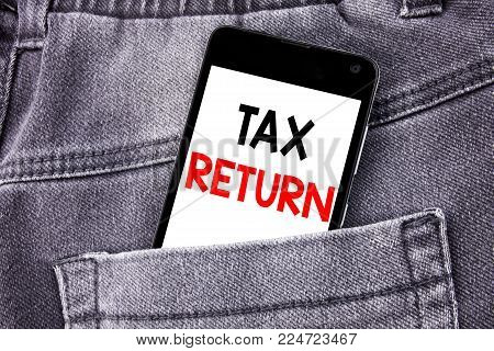 Conceptual hand writing text caption showing Tax Return. Business concept for Accounting Money Return written mobile cell phone with space in the back pants trousers pocket
