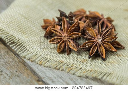 Star Anise Spice Fruits And Seeds Isolated On Wood Background Closeup. Anise Star Seeds On The Woode