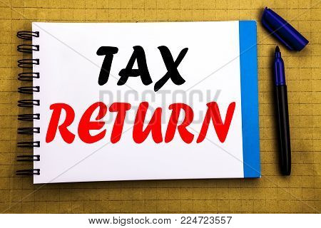 Tax Return. Business concept for Accounting Money Return Written on notepad paper background with space office view with pencil marker