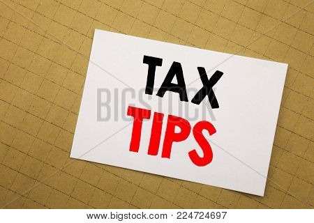Conceptual hand writing text caption inspiration showing Tax Tips. Business concept for Taxpayer Assistance Refund Reimbursement Written on sticky note yellow background
