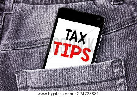 Conceptual hand writing text caption showing Tax Tips. Business concept for Taxpayer Assistance Refund Reimbursement written mobile cell phone with space in the back pants trousers pocket