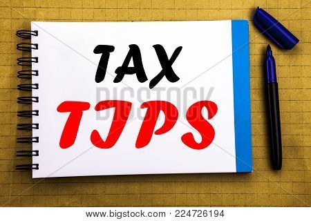 Tax Tips. Business concept for Taxpayer Assistance Refund Reimbursement Written on notepad paper background with space office view with pencil marker