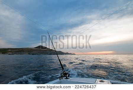 Sunrise View Of Fishing Rod On Charter Fishing Boat On The Pacific Side Of Cabo San Lucas In Baja Ca
