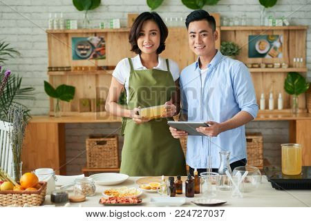Small business owners: young couple making and sell soap