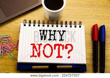 Hand writing text caption showing Why Not Question. Business concept for Leadership Motivation written on notebook on the wooden background in the Office with laptop coffee