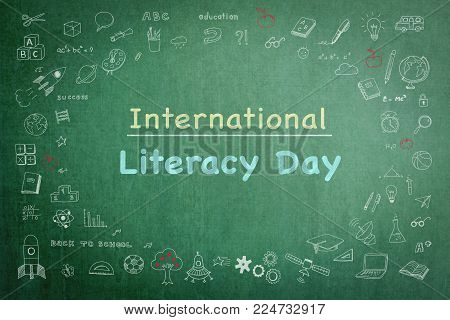 International literacy day on green chalkboard with doodle