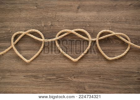 Three heart shapes made of rope knot