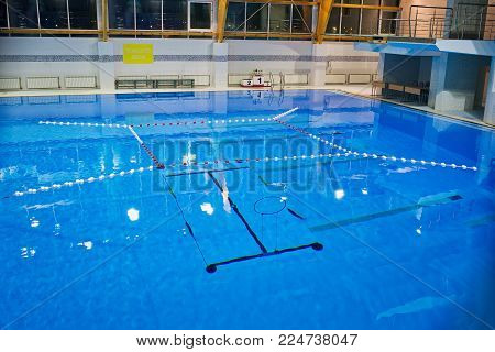 Empty swimming pool, clear water surface. Calm before aquatlon competition-underwater struggle.