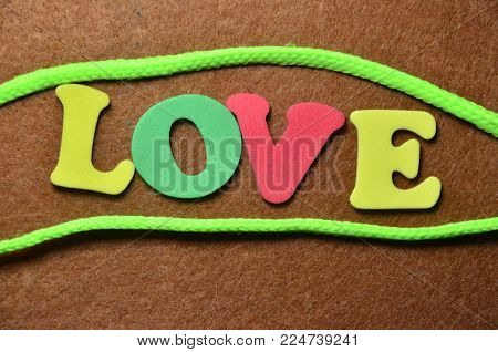 word love on an   abstract colored background