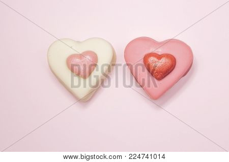 happy valentines, photograph of two heart-shaped cakes on a pink background