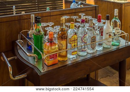 Bottles Of Assorted Selection At A Restaurant Bar, Ready To Make Mixed Cocktails Brands Martini, Joh