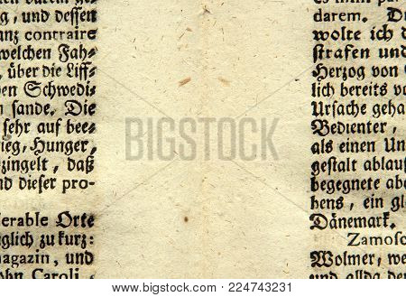 Kiev, Ukraine - February 02, 2018: ILLUSTRATIVE EDITORIAL An ancient sheet of paper with old german gothic letters illustrates the old paper making technology, circa 1736