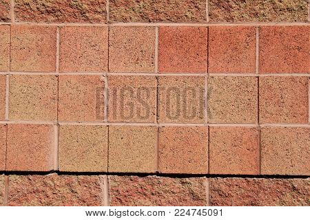 Horizontal image in design of peach - color brick background.