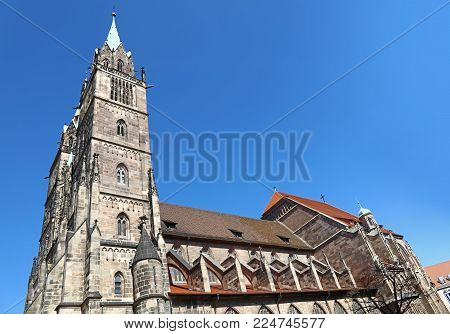 Saint Lawrence cathedral (St. Lorenz) over clear blue sky, medieval gothic church in Nuremberg, Germany, low angle side view