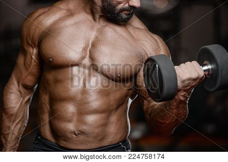 Old Brutal Strong Bodybuilder Athletic Men Pumping Up Muscles With Dumbbells