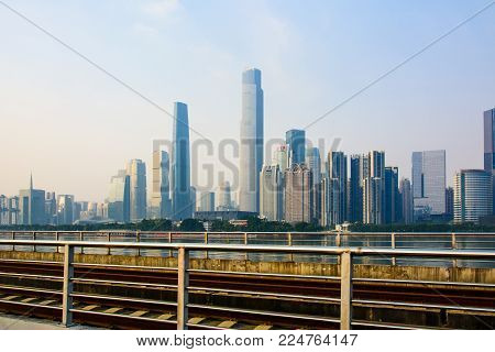 GUANGZHOU, CHINA - JANUARY 3, 2018: Guangzhou city rail road with the Guangzhou city landmark view in the background at sunset