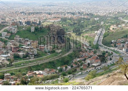 Izmir, Turkey - April 20, 2012: Panorama of the big city of Izmir and a view of the bas-relief of the first president of Turkey Ataturk, carved in a rock, from a high hill.