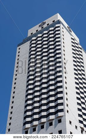 Izmir, Turkey - April 22, 2012: The modern building of the Hilton hotel against the blue sky in the city of Izmir. The five-star Hotel Hilton is located in the center of Izmir, it is a favorite and popular part of the city of Izmir among visitors.