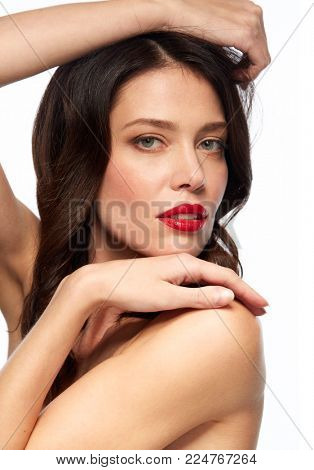 beauty, make up and people concept - close up of happy smiling young woman with red lipstick posing over white background