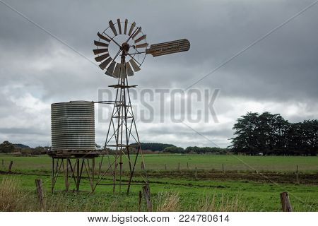 Windmill and water tank in the Australian farming district