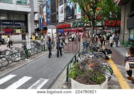 TOKYO, JAPAN - MAY 8, 2012: People shop in Shinjuku, Tokyo, Japan. The Greater Tokyo Area is the most populous metropolitan area in the world (38 million people).
