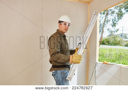 Mechanic mounting window at construction site