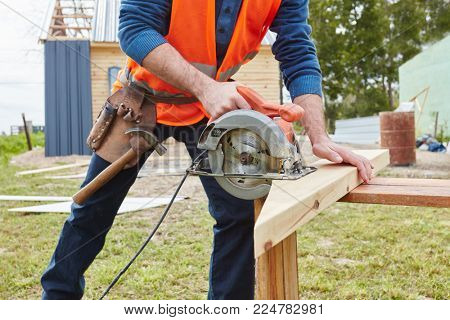 Circular saw used by craftsman during DIY construction project