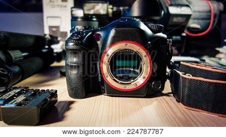 Camera body with accessories and blurred background