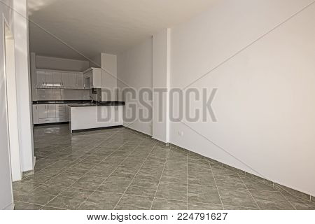 Interior decor kitchen design with appliances and furnishings in luxury modern empty unfinished show home apartment