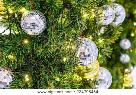 Christmas Decoration With Many Glitter Bauble Balls, Shinny Baubles And Pine Cones On The Artificial