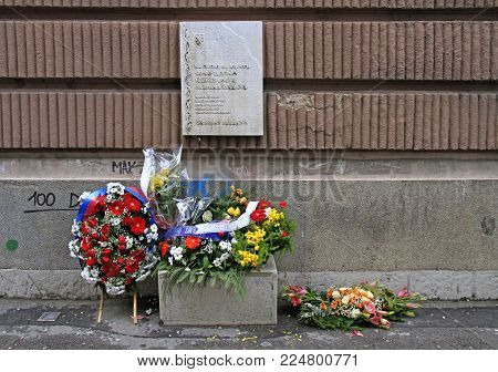 Sarajevo, Bosnia and Herzegovina - December 18, 2017: wreath and flowers on place of death of people in bosnian war in Sarajevo, Bosnia and Herzegovina