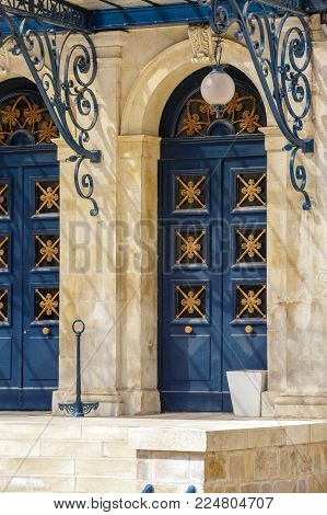 Close up on vintage blue carving door with wrought iron decoration