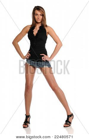 Young Woman wearing a mini skirt  posing isolated on a white background