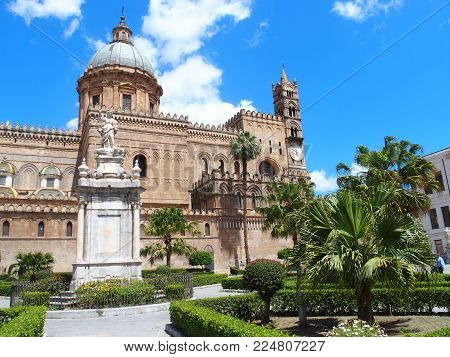 PALERMO Cathedral church in SICILY, towers of medieval building in ITALY with cloudy blue sky in 2016 warm sunny spring day, Europe on May.