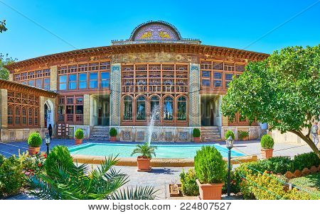 Shiraz, Iran - October 12, 2017: The Facade Of Zinat Ol-molk Historic Mansion With Fountain And Scen