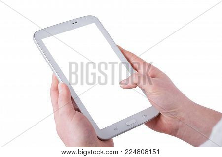 Tablet in women hands isolated on a white background