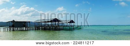 Panoramic view of stilt houses over the clear blue water. Phu Quoc island, Vietnam.