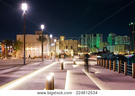 DUBAI, UNITED ARAB EMIRATES - JANUARY 30, 2018: Al Fahidi Historical neighborhood entrance night view, a historic district in Dubai, United Arab Emirates (UAE)
