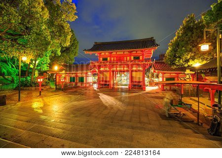 Main gate Ro-mon of Yasaka Shrine illuminated at night on the main street Higashi Oji Dori.
