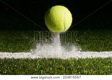 Match point with a tennis ball hitting the line