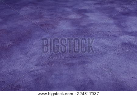Ultra violet marble or concrete background (shallow DOF, selective focus), concept of the Ultra Violet as the Color of the Year 2018