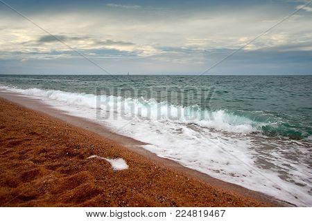 beautiful sunny sandy beach and cloudy sky
