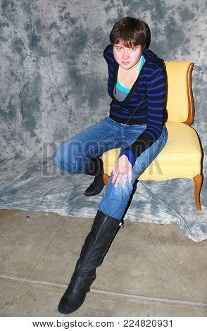 Female beauty fashion model posing in s grunge studio basement.