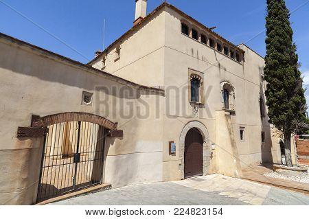 SANT BOI DE LLOBREGAT,SPAIN-MAY 21,2017:Ancient medieval manor house Can Torrents.Sant Boi de Llobregat,Catalonia,Spain.