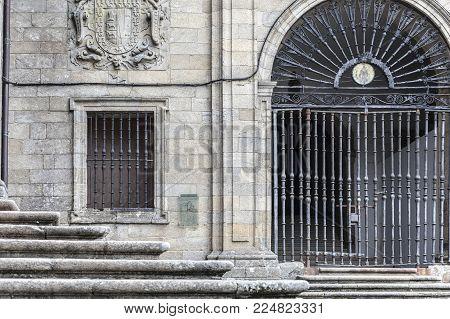 SANTIAGO DE COMPOSTELA,SPAIN-NOVEMBER 22,2017:Ancient building, iron gate entrance church San Domingos de Bonaval.Santiago de Compostela,Spain.