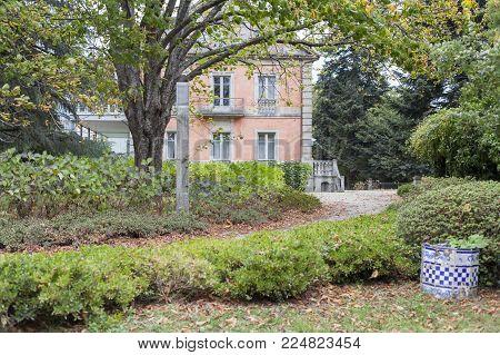 SANTIAGO DE COMPOSTELA,SPAIN-NOVEMBER 22,2017:Park, Parque Vista Alegre and colored house Casa Europa.Santiago de Compostela,Spain.